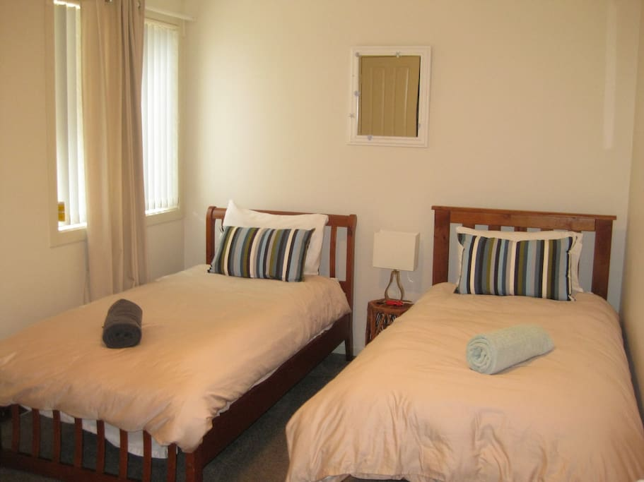 Cosy and very private 2nd bedroom with walk in wardrobe and plenty of spare blankets.