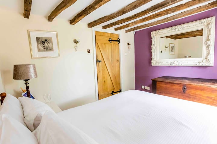 another downstairs double bedroom, this one has floor to ceiling windows overlooking the horses fields... a beautiful view to wake up to.