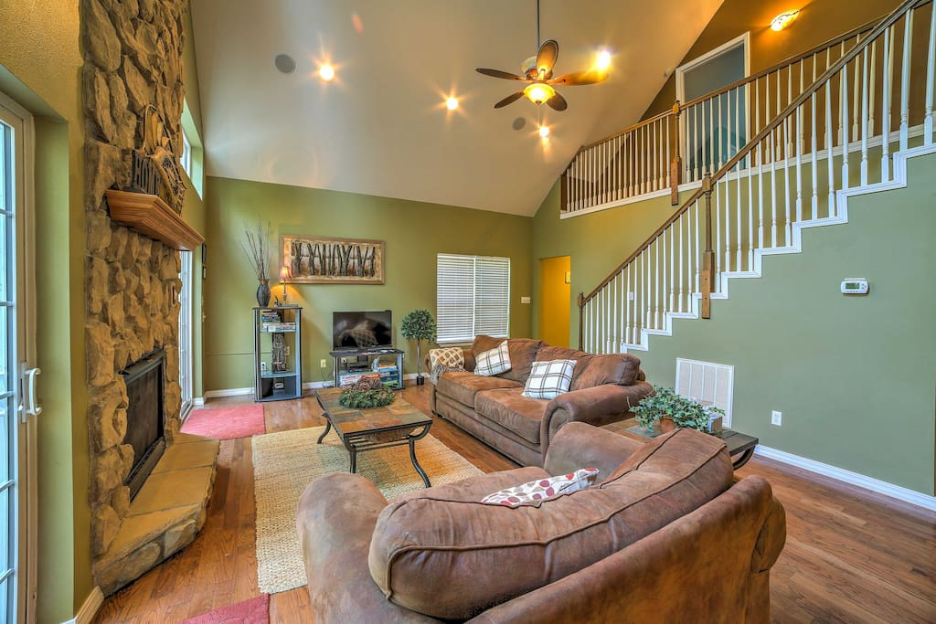 Unwind by the fireplace and relax on the comfy couch in the living room.