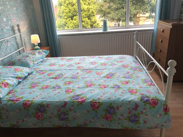 Bedroom number 1, double bed with views over the garden and playing fields behind.
