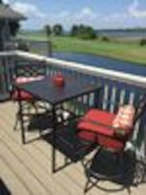 Tall bistro table overlooking the stocked pond, golf course, bay, village and marina.....breathtaking