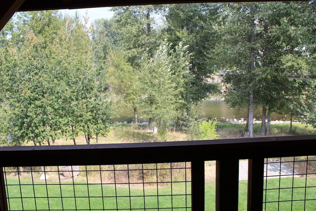 The Methow River Lodge and Cabins view of the Methow River from second floor balcony.