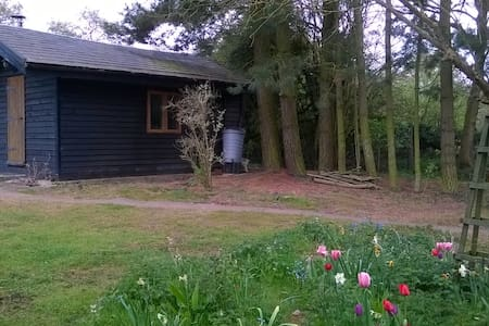 Rural self- contained cabin with log burner