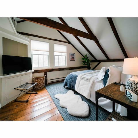 Incredibly cozy primary bedroom equipped with smart TV, salt lamp, alarm clock & linen spray.