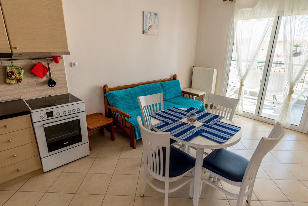 Apartment 2. floor: living room with kitchen and big terrace with BBQ!