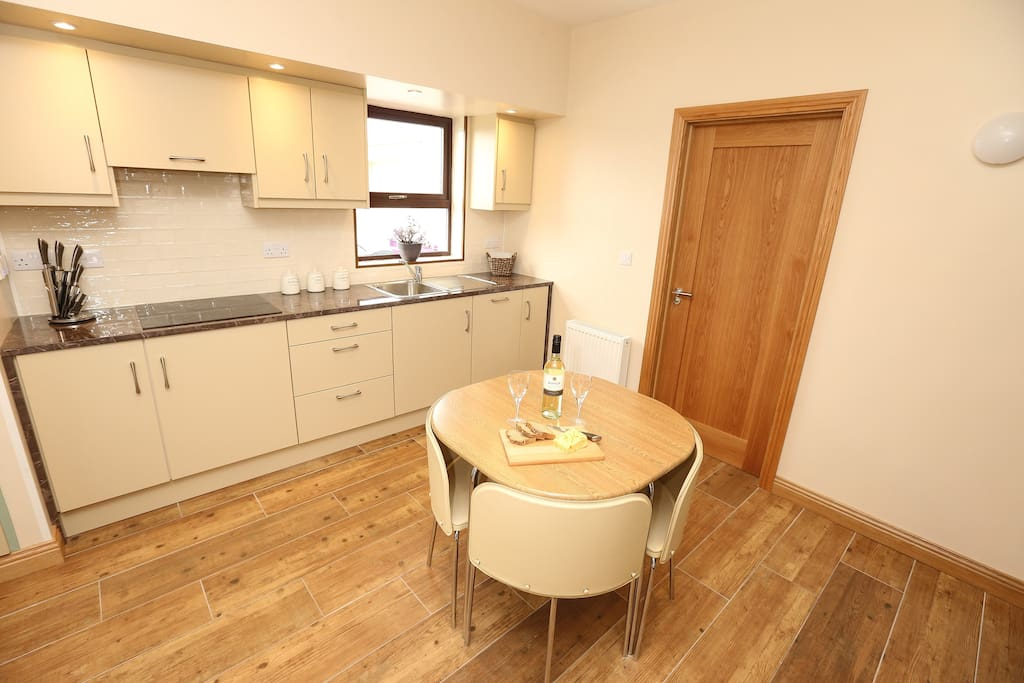 Kitchen/Sitting area - hob, integrated dish washer and bins, kettle, toaster, pots, pan, utensils and all cutlery and dishes etc.