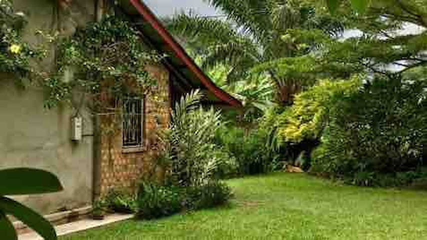 Garden setting, ideally located close to airport.