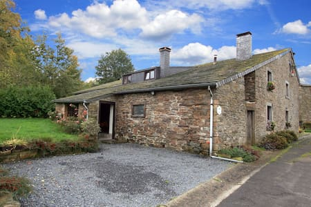Semi-detached farm situated at the edge of the woods