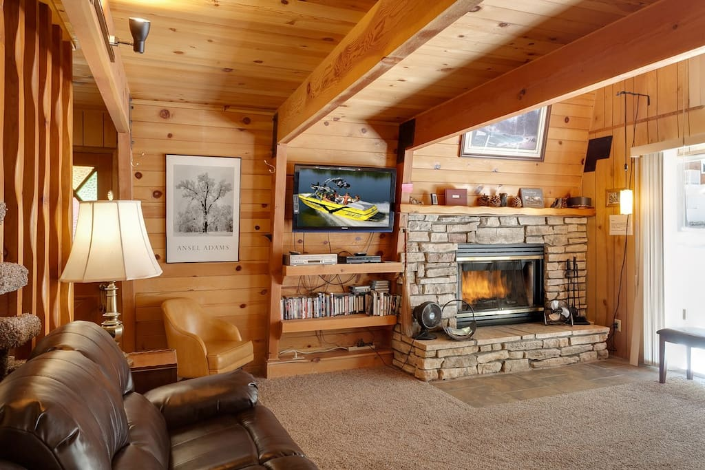 Open Living Area with Flat Screen TV and Log Fireplace.