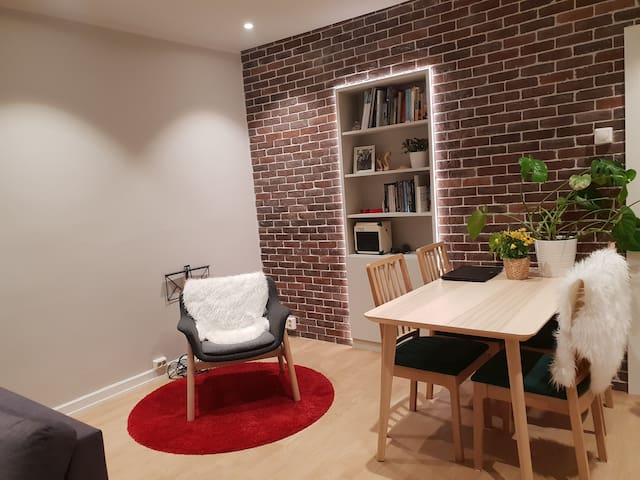 Stylish living room with place to have dinner, read a book, watch TV and enjoy music from ceiling speakers