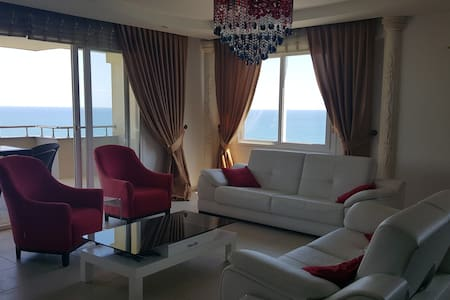 Big flat with aquapark and beautiful view - Mezitli