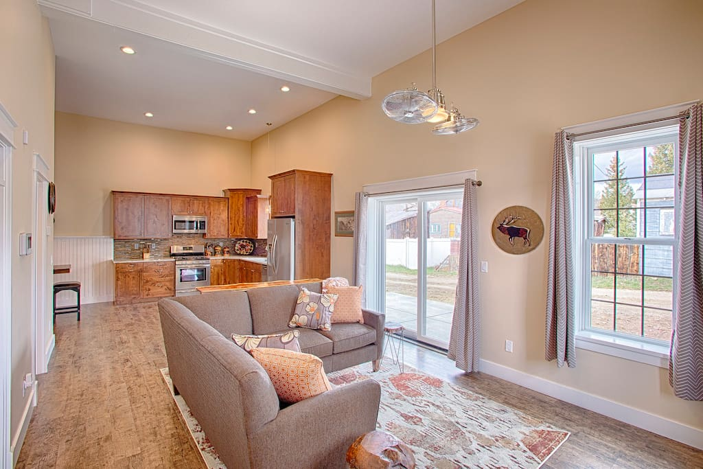 Open concept Living Room, Kitchen and Dining. Comfortable and cozy. Sliding glass door accesses private patio.