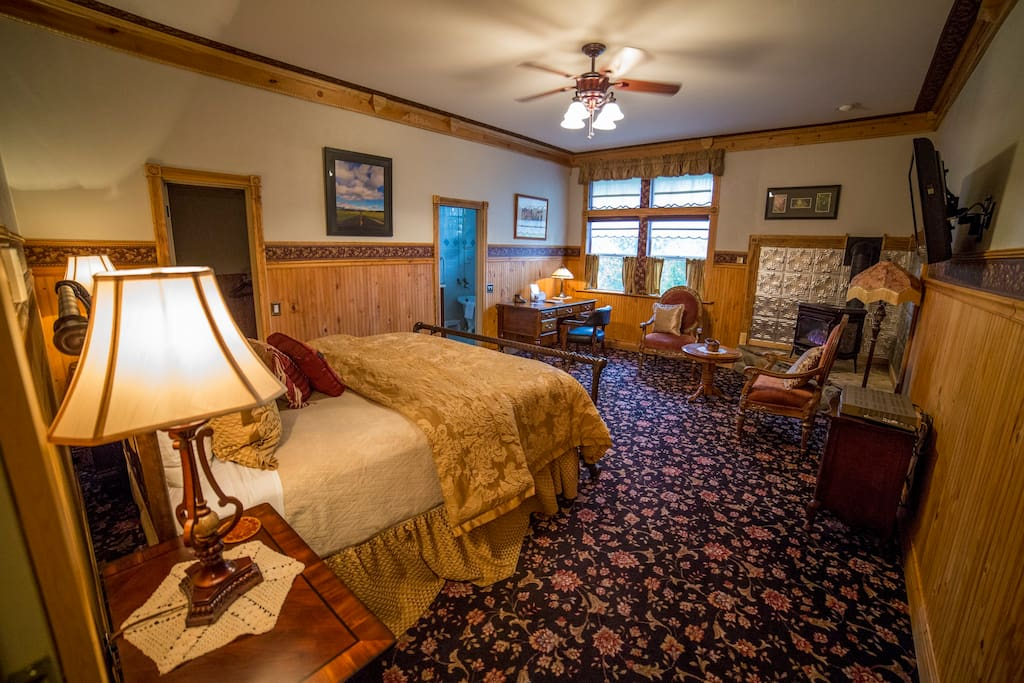 Enjoy a super comfortable California King sized bed, with gas fired wood stove, writing desk, and sitting area