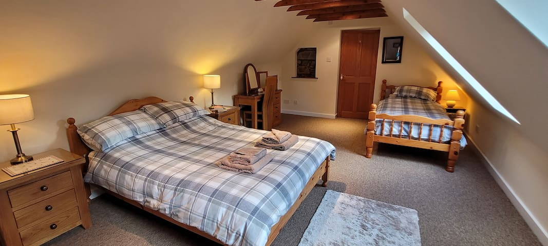 Bedroom 1 - double & single bed (2 people max, second bed is purely option for a twin room basis).  Large spacious room, with plenty of storage. 2 velux windows.