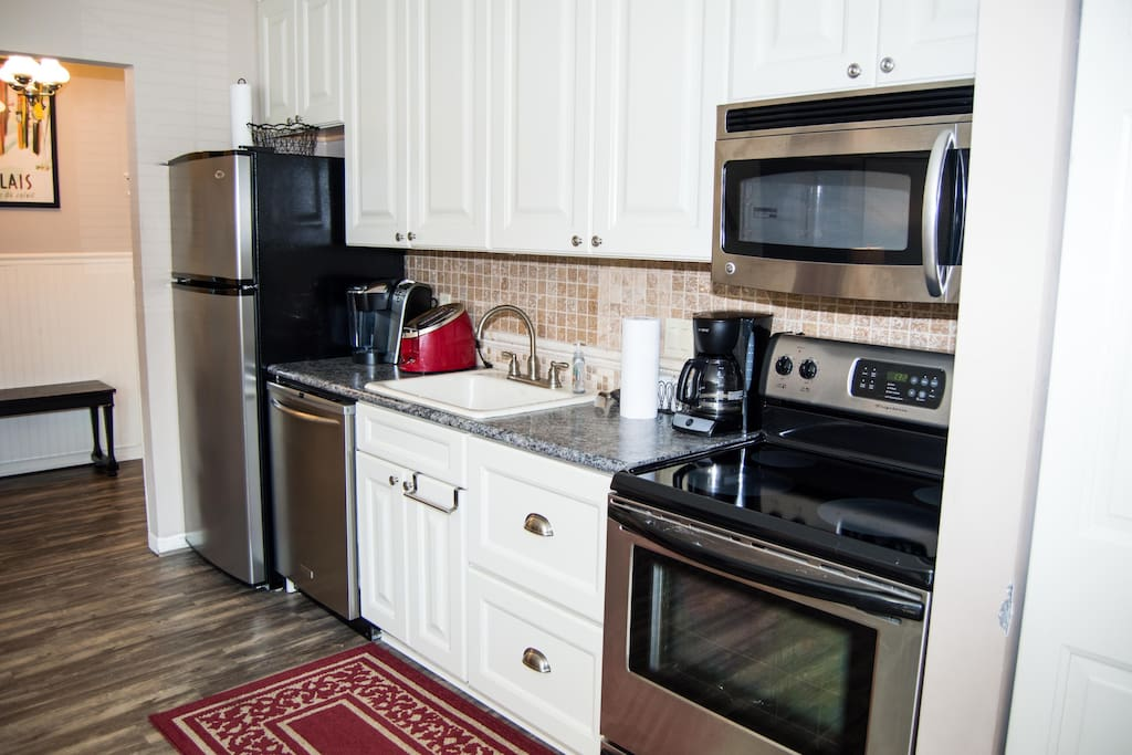 Beautifully remodeled kitchen with large appliances.