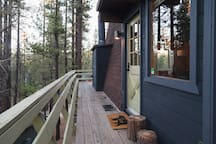 The deck wraps around 3/4 of the cabin.