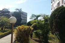 Entrance to the condominium by security and a beautiful landscape.