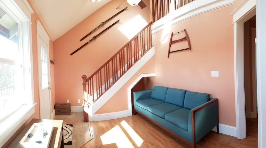 Vintage mid-century furniture can be pushed under the stairs to accommodate larger gatherings or for new friends who want to shade their face from the sun in the morning.
