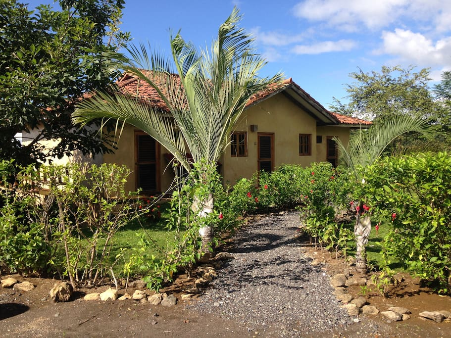 Beautiful gardens add to the privacy of this end of the cul de sac villa.