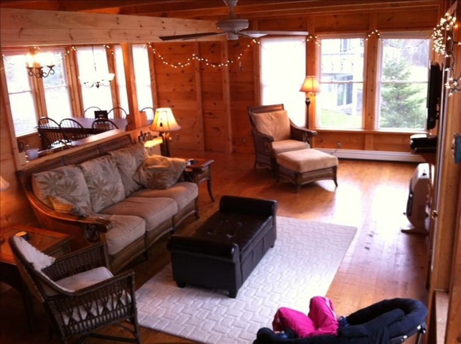All wood adds cabin-like feel and wonderful smell. This is the first floor gathering room with amazing views of the lake