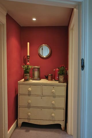 The small lobby between the bedroom and your bathroom.   A kettle, tea, coffee, mugs etc are supplied for your early morning cuppa.