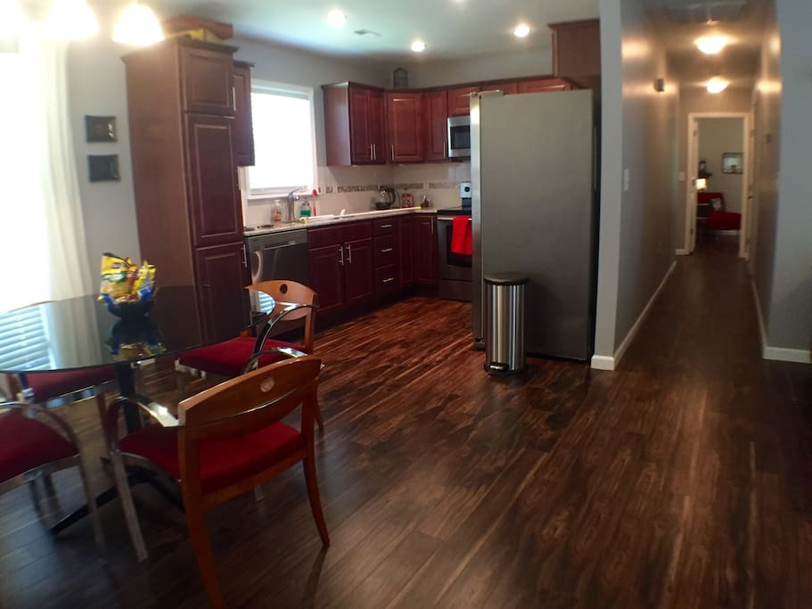 From the entry, you can see the dining area and the new kitchen, along with the laminate floors that run throughout the house!