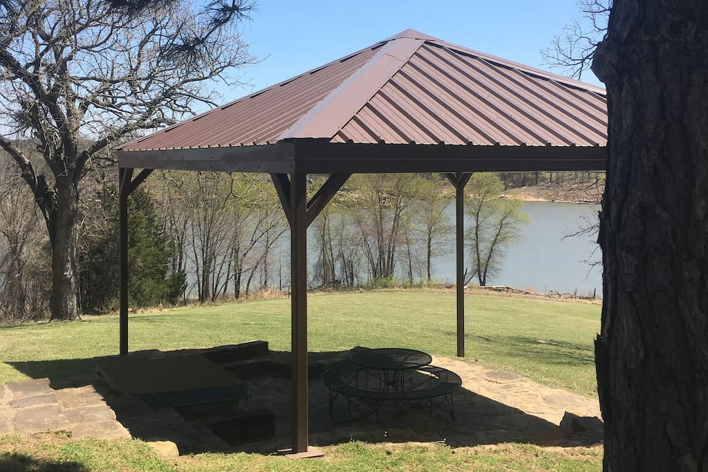 Picnic shelter next to house with winter lake view