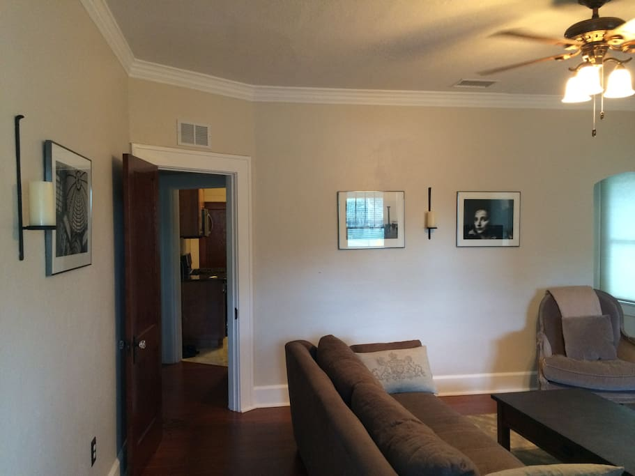 Another view of the living room leading into the hall & gourmet kitchen.