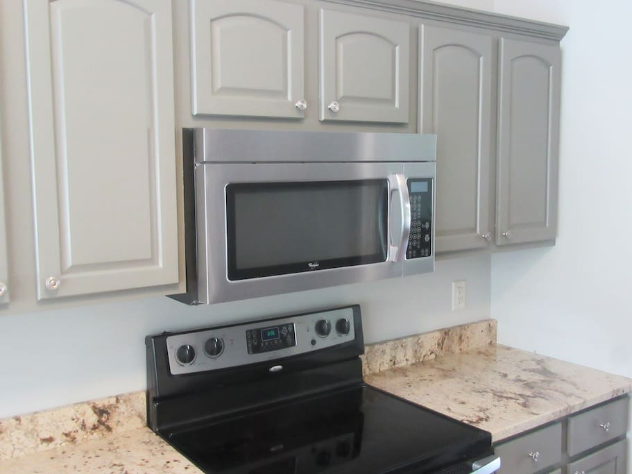 Brand New Cabinets. Granite Counter Tops. Built-in Microwave.