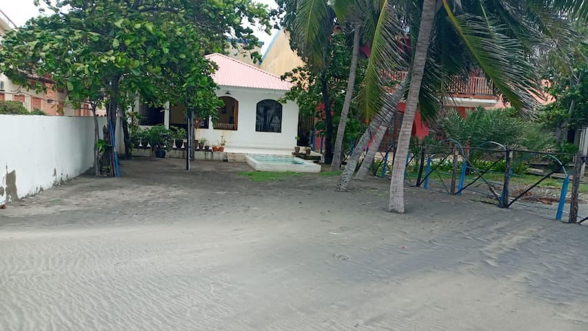 House and guest house on the beach with small pool