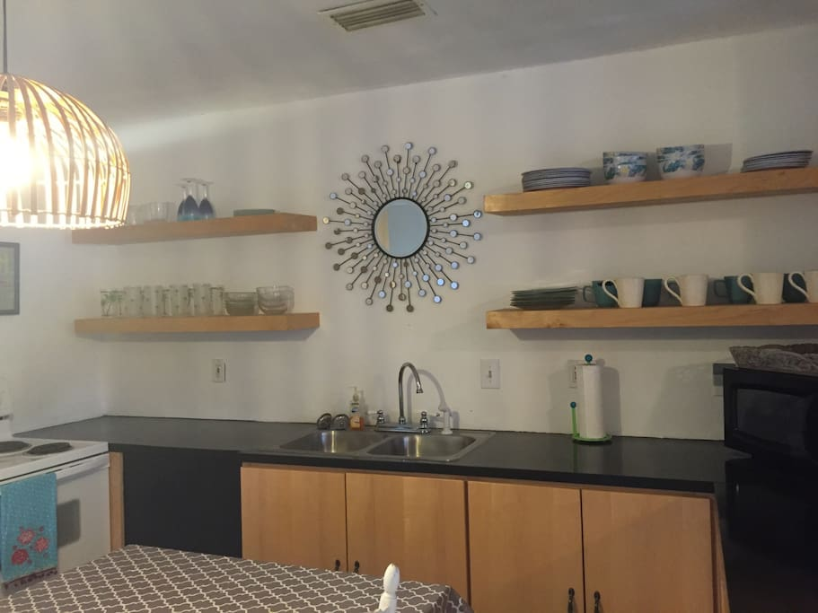 Custom kitchen opens to living room