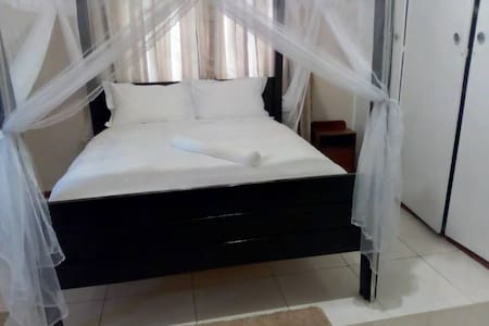 Queen size bed..main house