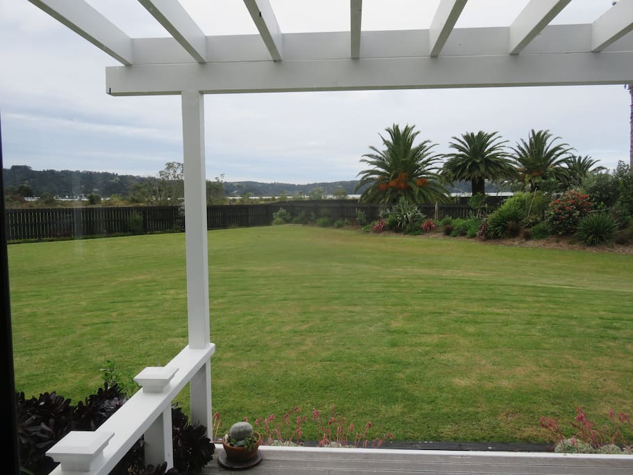 View across lawn to the Whangateau harbour.
