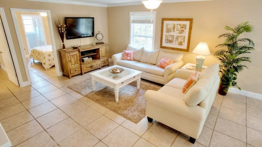 Living room - Relax on the comfortable sofas, watch a show on the flat screen TV or a movie on the smart Blu-ray, or listen to your favorite tunes through the Bluetooth Sound System. You will also find games, books, and movies.
