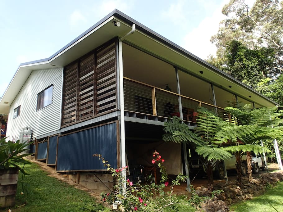 """House on gentle slope high side """"back veranda"""" with 2 car spaces under."""
