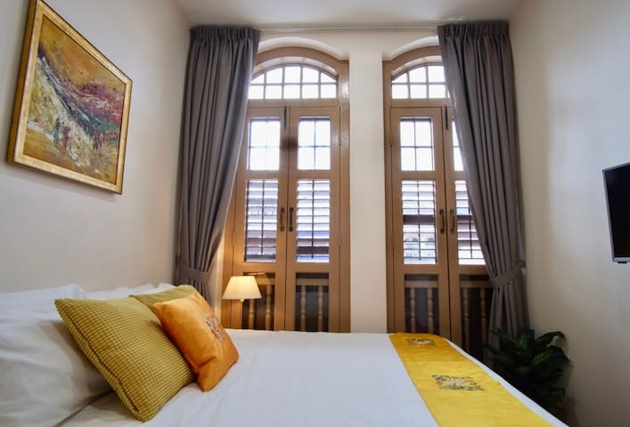 The gorgeous heritage house windows let in plenty of natural light.