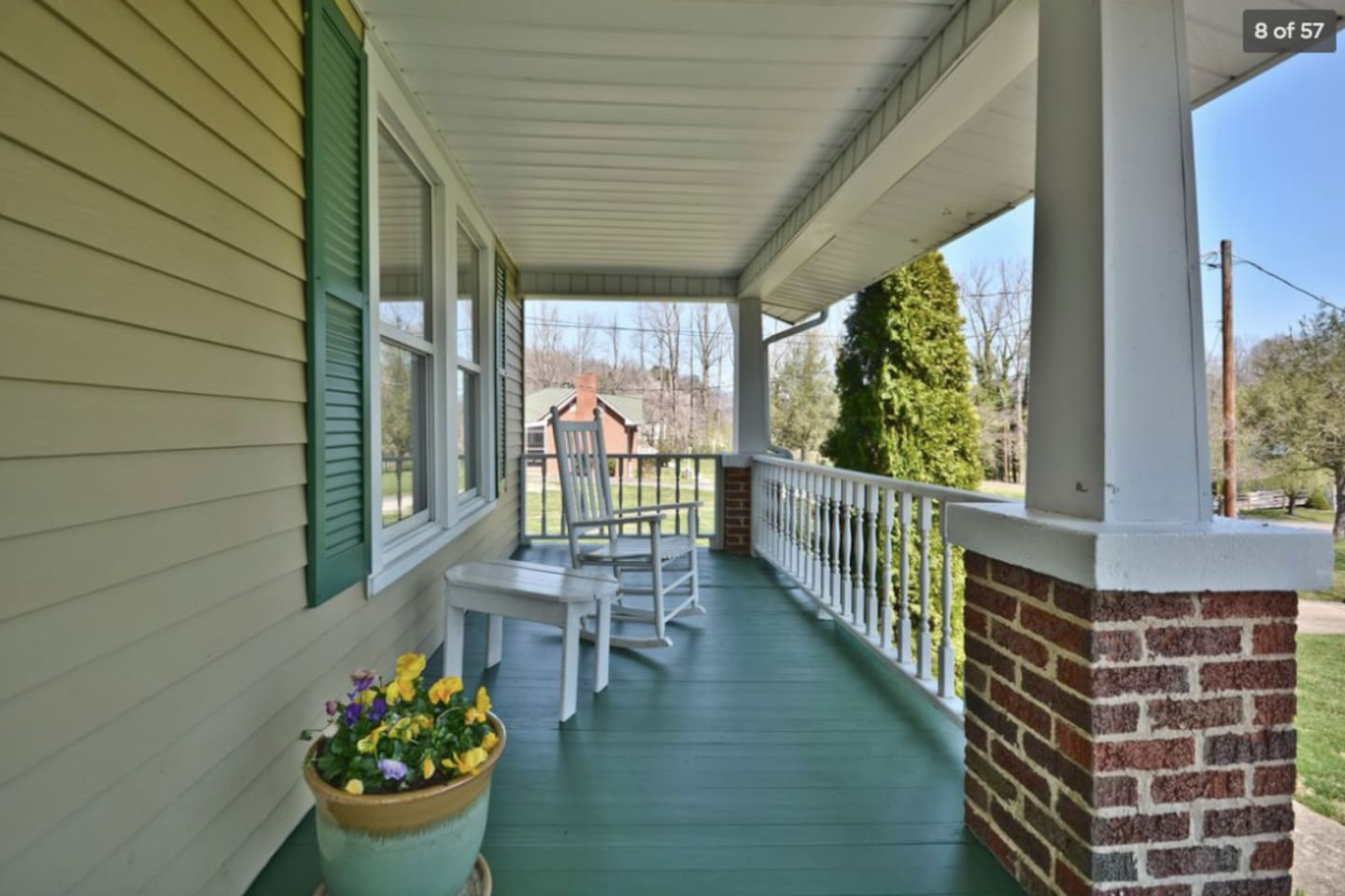 A wide front porch with rockers offers a scenic view down to the creek, while a screened-in porch with table and chairs for al fresco dining offers privacy for a glass of wine in the evening. Also, a firepit is available for toasting marshmallows.