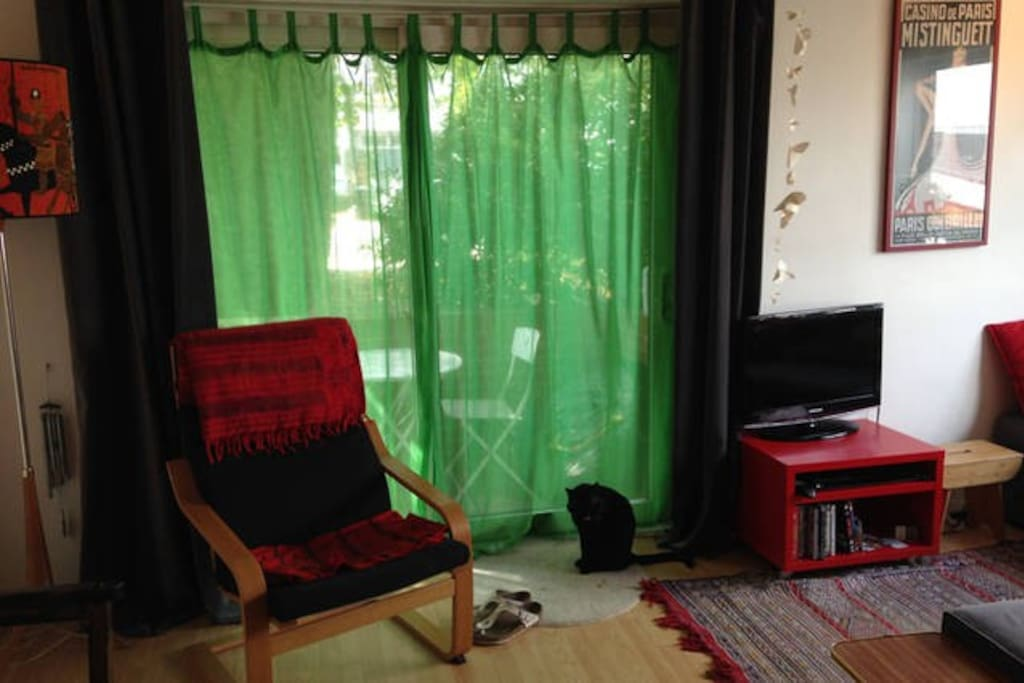 Living room that leads onto patio.....The cat is not there at the moment :)