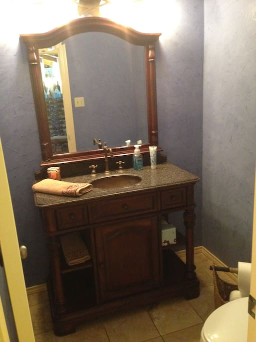 Half bathroom by bedroom