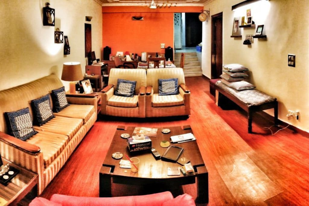Panoramic view of the living area along with a dining table for 4 that you are welcome to use