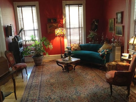 Our music room, parlor, and pottery display area