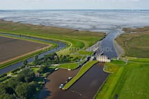 Nieuwe Statenzijl Dollard  : This is the very last point of the Netherlands. It's a very special place to visit but don't forget to walk to the Kiekkaast and see the different birds :)