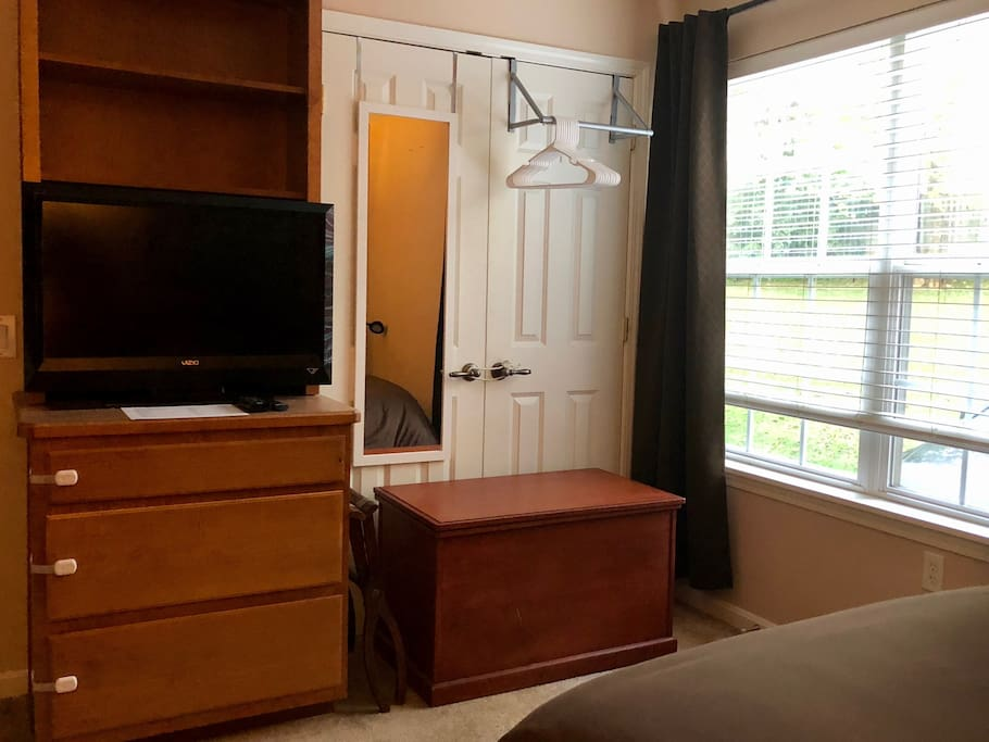Guest Bedroom's TV with access to plenty of TV Shows and Movies and hanging closet.