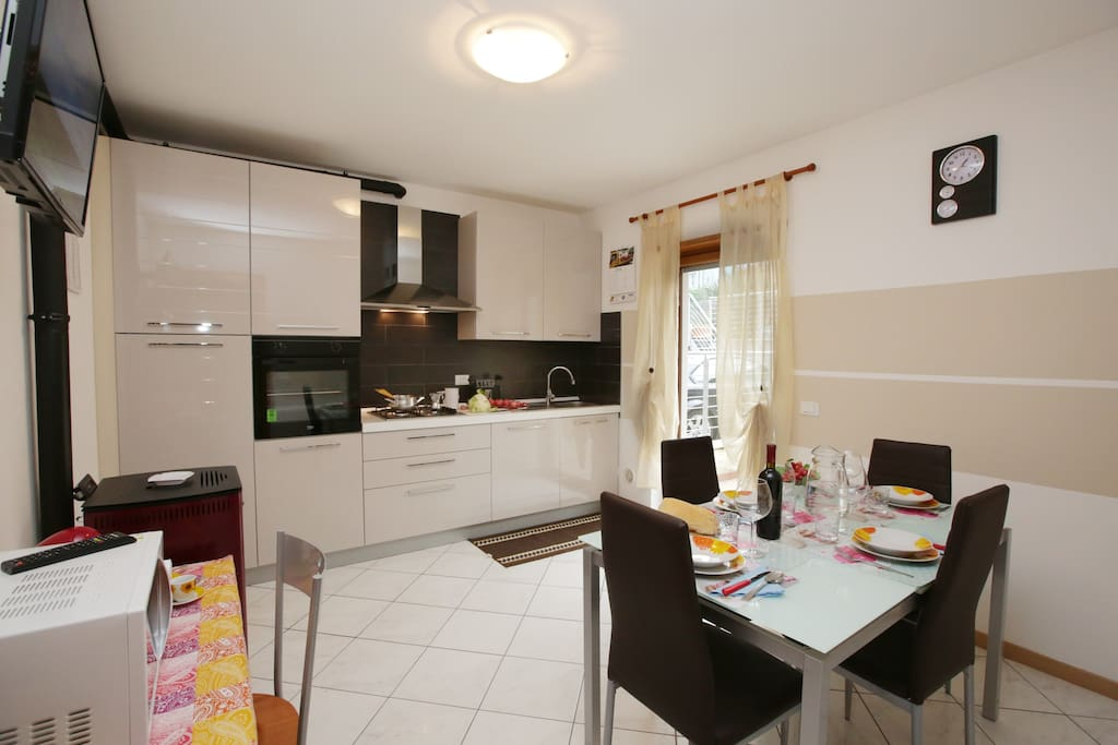 The fully equipped kitchen with dishwasher, cooker hob, oven, Microwave