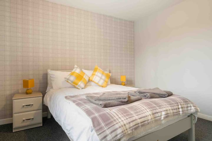 One of our second story double rooms with memory foam mattress for a fantastic nights sleep. Bed side lockers and chest of drawers