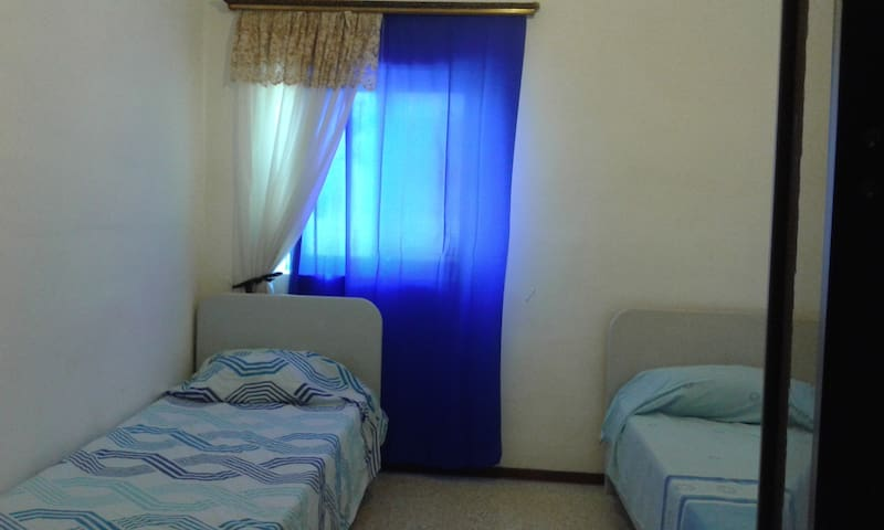 Well-lit, airy  bedroom in Mosta