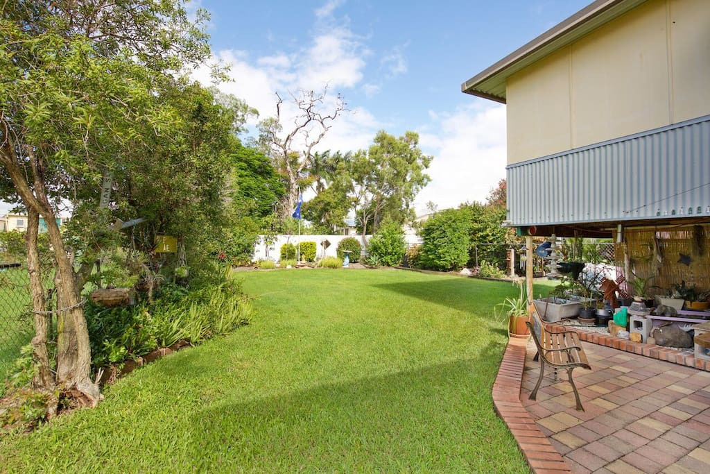 Fully fenced backyard and lovely garden area