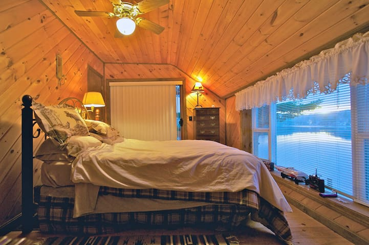 This is the master bedroom, ground level. Wake up and look over your toes at views to die for. The calls of the Loon will startle those unfamiliar with this fowl.