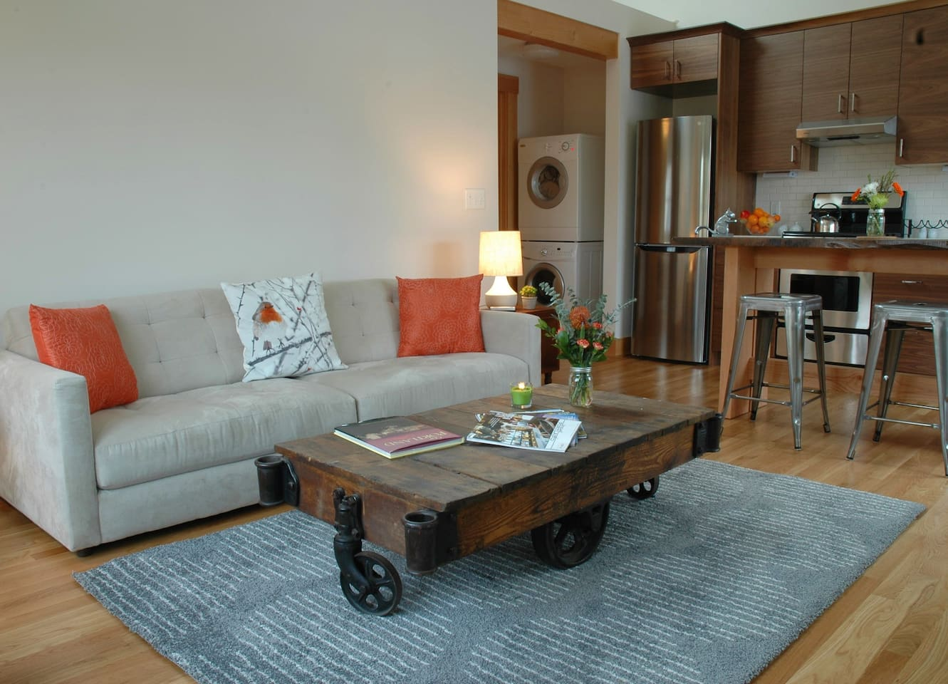 Cozy modern couch and antique warehouse cart coffee table