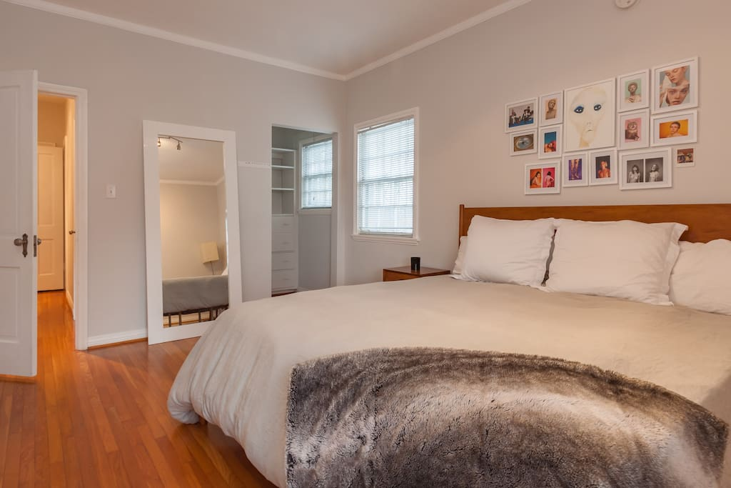 Large bedroom with King Size Casper Mattress and super soft West Elm Belgian linens, floor length mirror, and ample closet space.